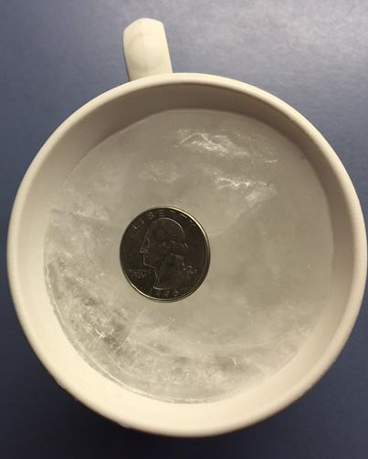 quarter-on-frozen-cup-of-water